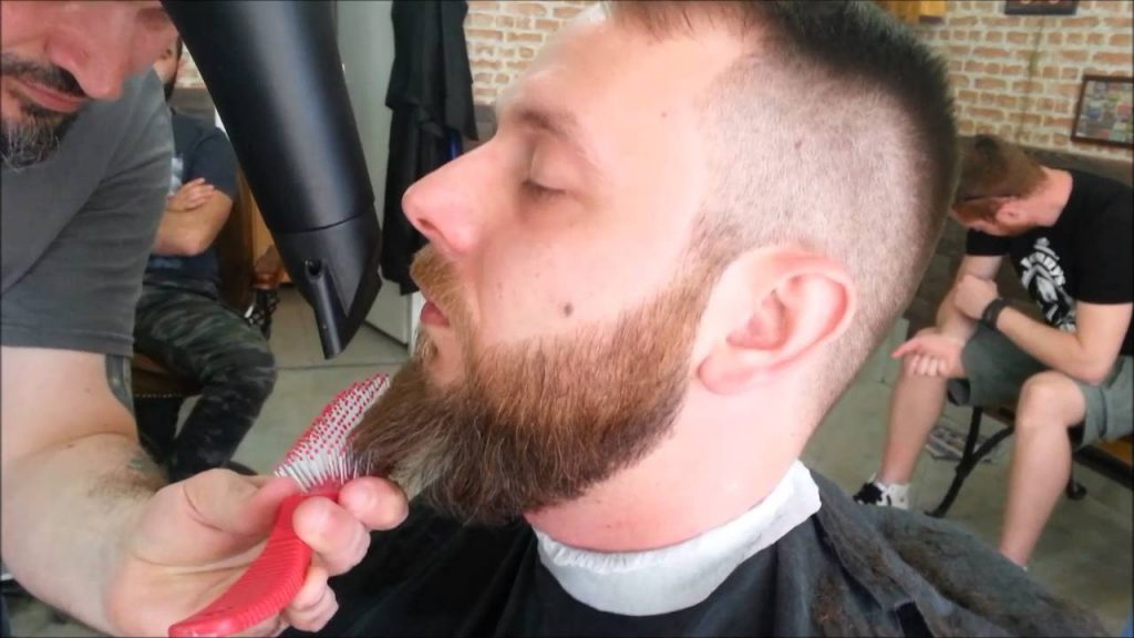 Using a Blow-dryer, straighten curly beard
